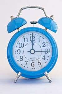 small blue alarm clock