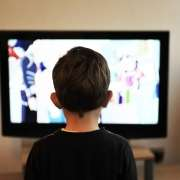 A young boy watching TV
